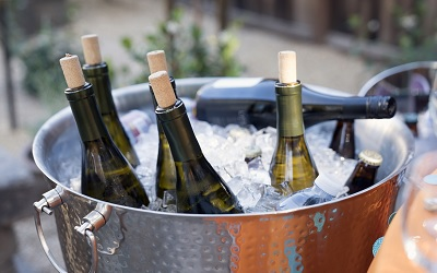 Wine Bottles in Bucket with Ice