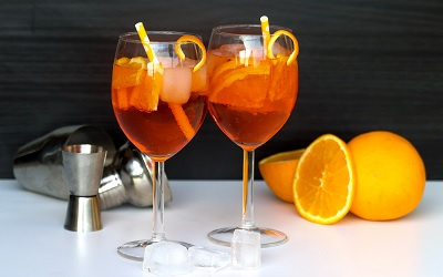 Two Glasses of Aperol Spritz with Ice Cubes and Orange Slices