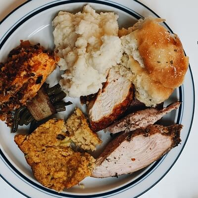 Cajun Style Turkey Dinner with Mashed Potatoes, Beans, and other Side Dishes