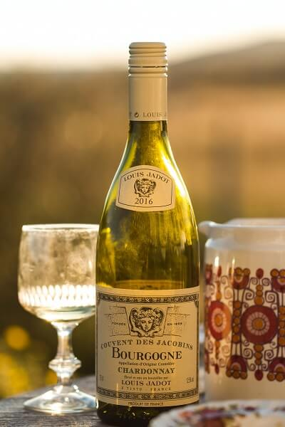 Bottle of French AOC White Wine with Glass