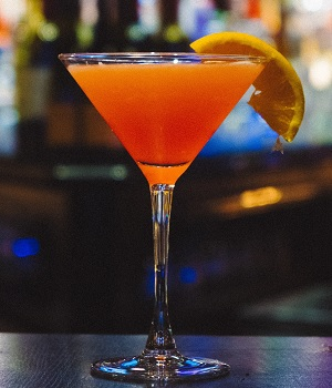 Martini Glass filled with an Orange Cocktail