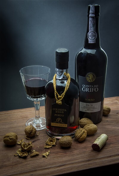 Bottle of Colheita Port Wine and Glass Filled With Red Wine