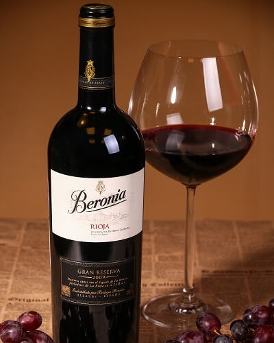 Bottle of Rioja Reserva Red Wine and Glass Filled with Red Wine