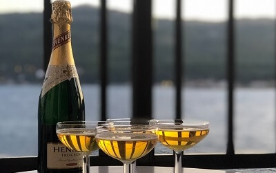 Bottle of German Sekt with Four Glasses Filled With Sparkling Wine