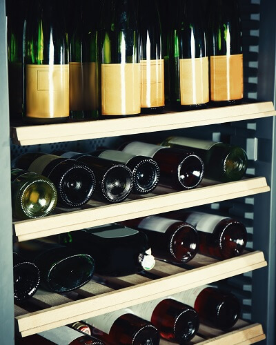 Wine Fridge filled with Wine Bottles