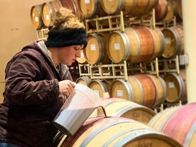 Vintner Blending Wine During Aging