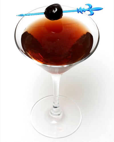 Dubonnet Manhattan Cocktail with a Cherry in a Martini Glass